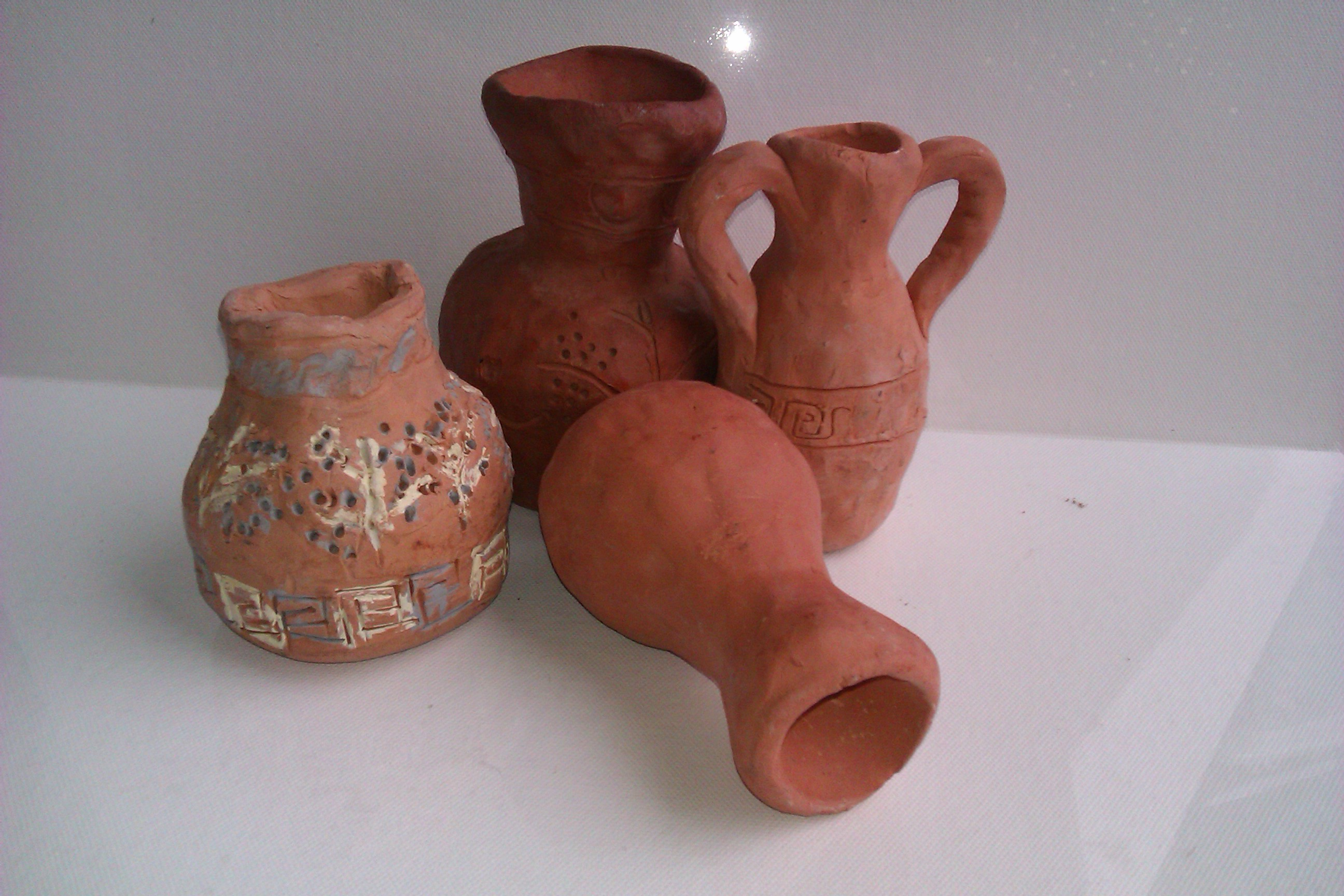 Greek pots in various stages art techniques for Clay pot painting techniques