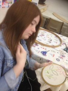 Jade works on an embroidery