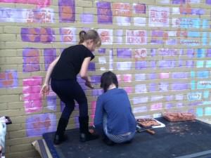 Saltdean Mural older pupils work on the high wall